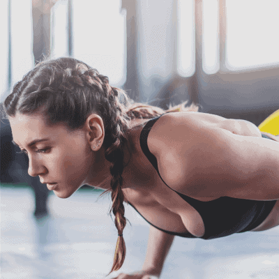 female runner with braids strength training with push ups