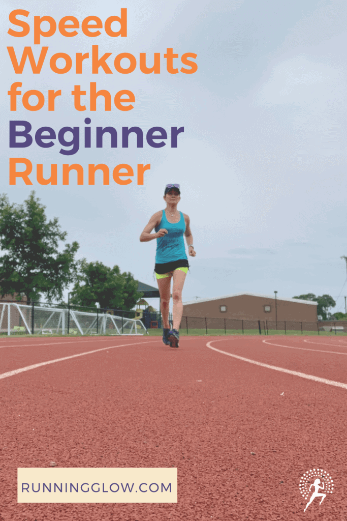 female runner on a track doing speed workout