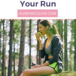 female runner eating apple in forest