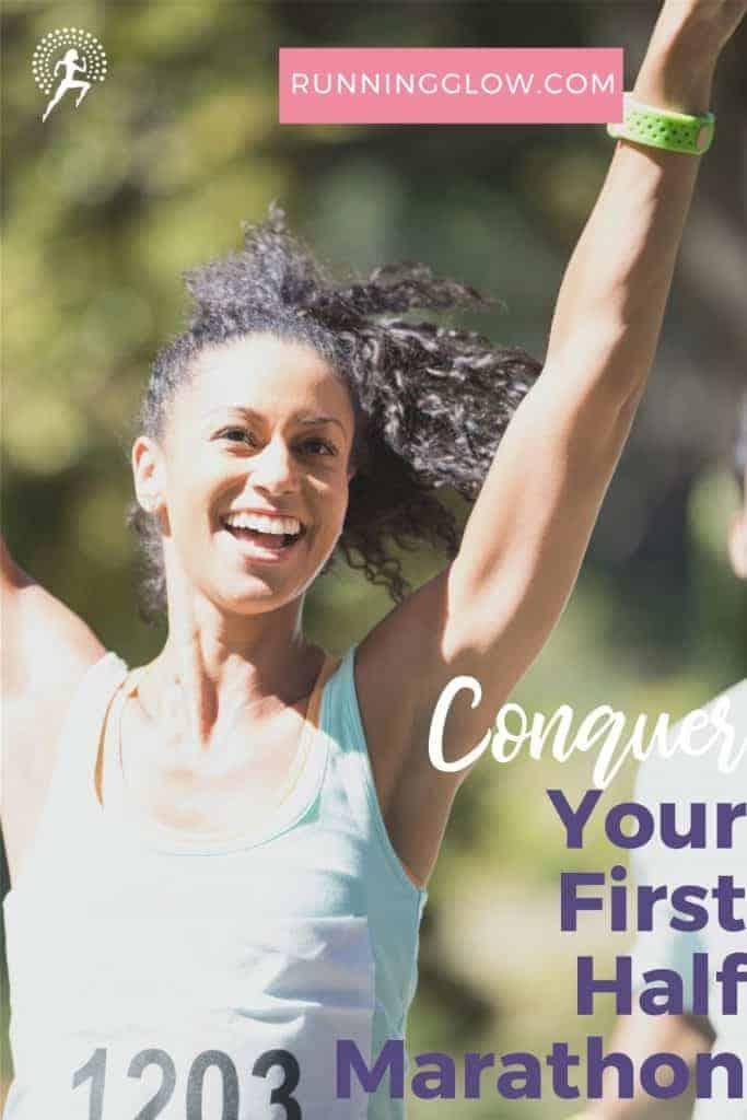 female runner arms up celebrating