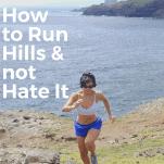 female running uphill near the ocean