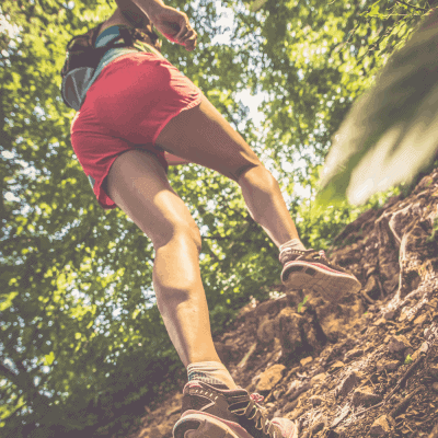 a runner going uphill on a trail