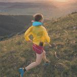 female running on mountain side