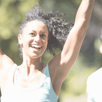 female runner smiling in 10K race