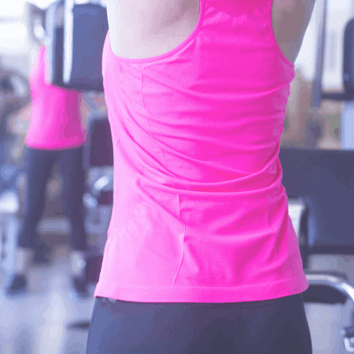 female runner upper body workout at gym