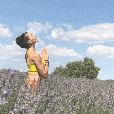 female runner practicing yoga in nature