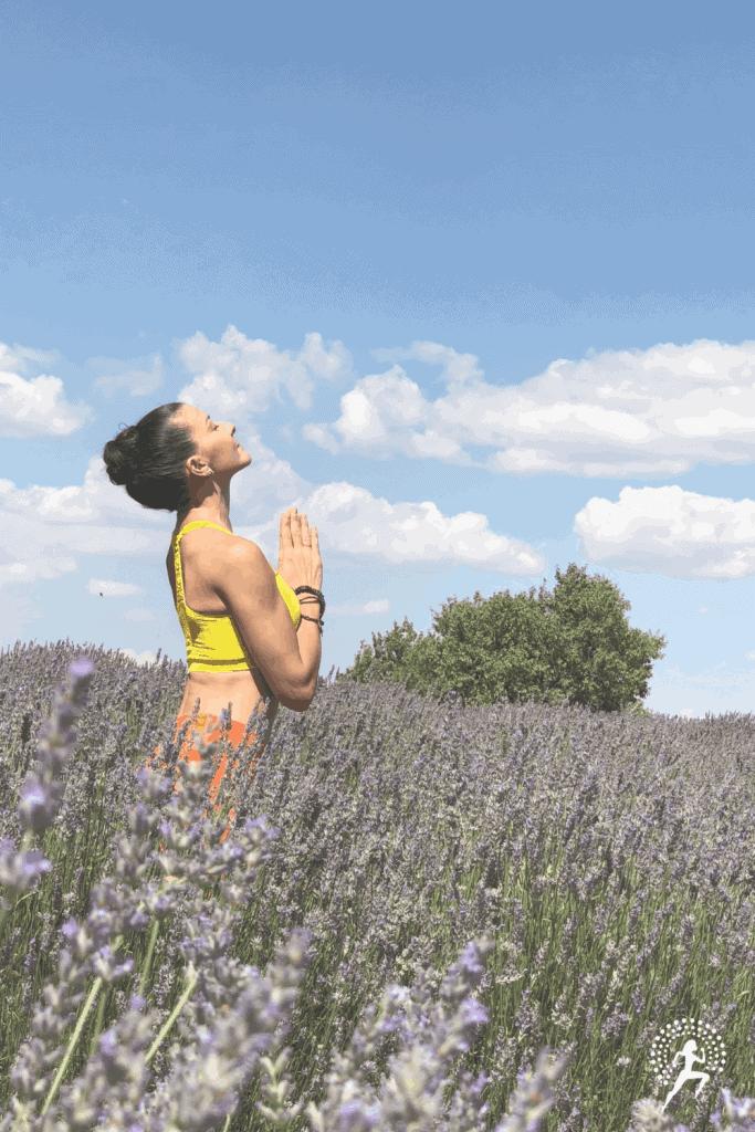 female runner practicing yoga in nature